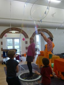 Person in a bubble during a bubble show.