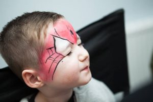 Spiderman face painting at a bubble party in Gloucester.